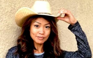 Michelle Malkin wearing a white cowboy hat and a black dress