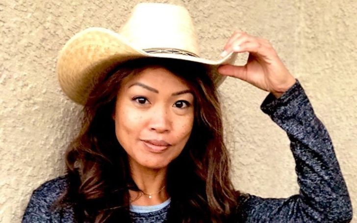 Michelle Malkin wearing a white cowboy hat and a black dress
