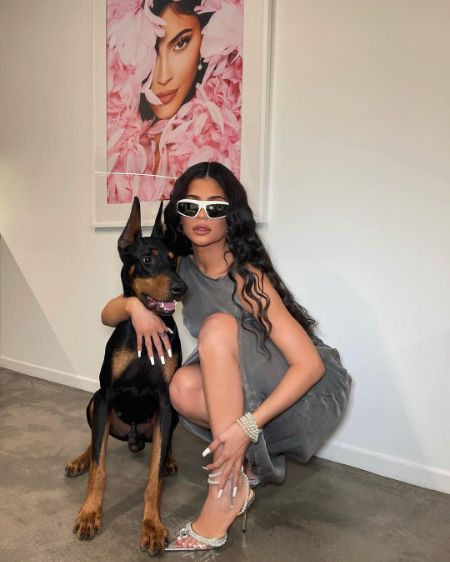 Kylie Jenner taking a picture with her dog
