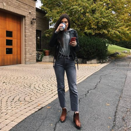The actress enjoying a cup of coffee