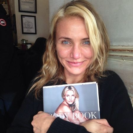 Cameron Diaz holding a magazine with her in the cover
