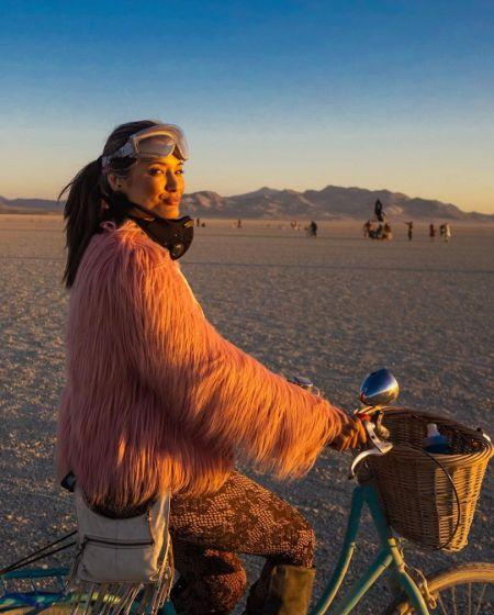 Kelly Hu riding a bike in Nevada
