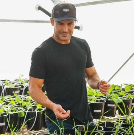 Zac Efron in the garden