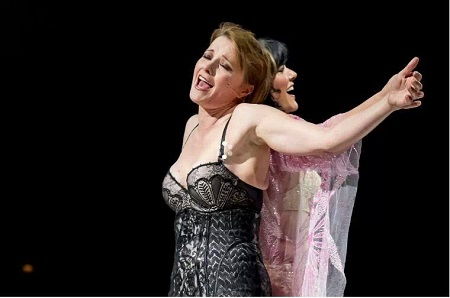 Lucy Lawless performing on stage