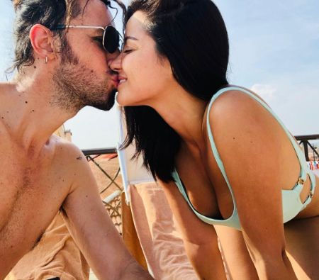 Maite kissing her partner Koko Stambuk