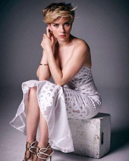 Scarlett Johansson in a white sleeveless dress