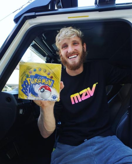 Logan Paul holding a box of Pokémon card