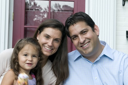Krystal Ball with her husband and her daughter