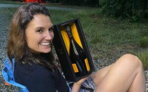 Kristal Ball holding a bottle of champagne