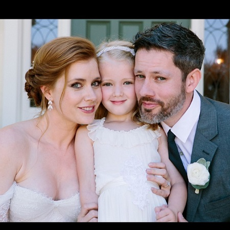 Darren Le Gallo with his wife and daughter