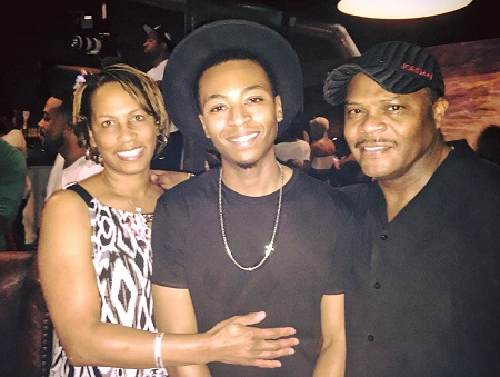 Kevin Ross with his father and mother