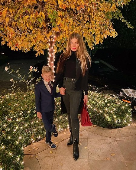 Fergie Alx Duhamel attending a party with her son
