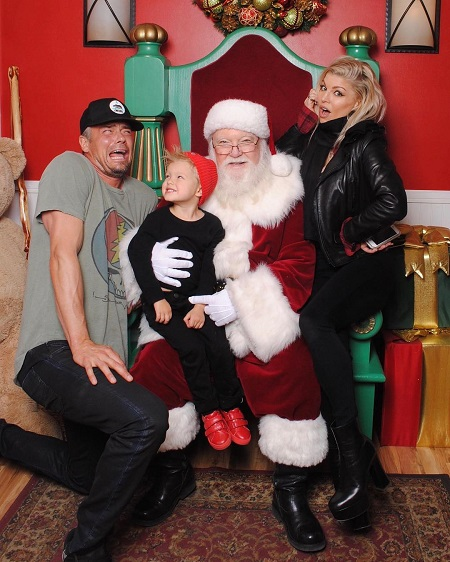Axl Jack Duhamel celebrating Christmas with is father and mother