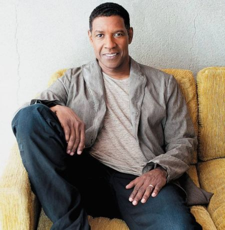 College athlete Denzel Washington posing on his couch