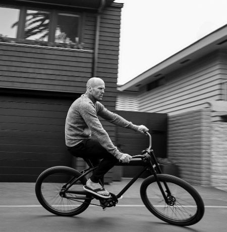 Common wealth athlete Jason Statham riding a bicycle