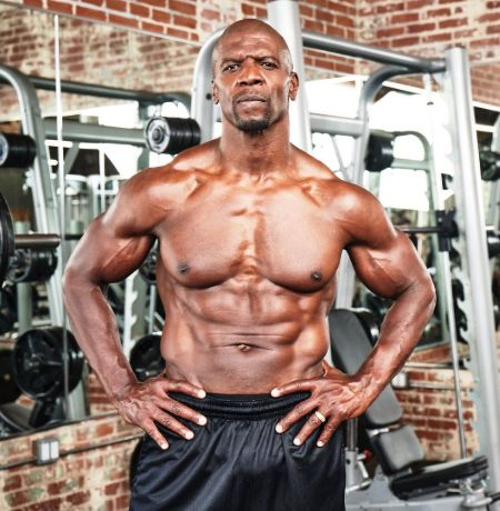 Former College football athlete Terry Crews flexing at gym