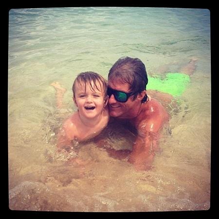 Maciah Bilodeau teaching his son to swim