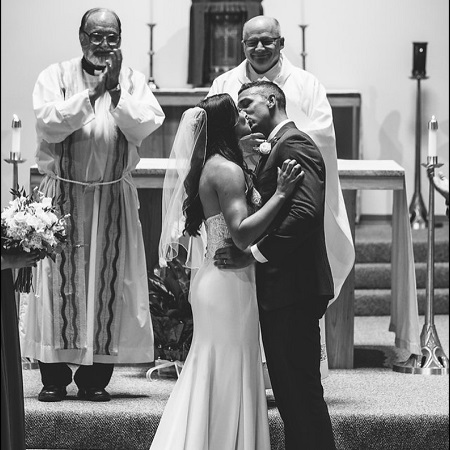 Kayla Braud The Espn game analyst kissing her husband on her marriage ceronomy