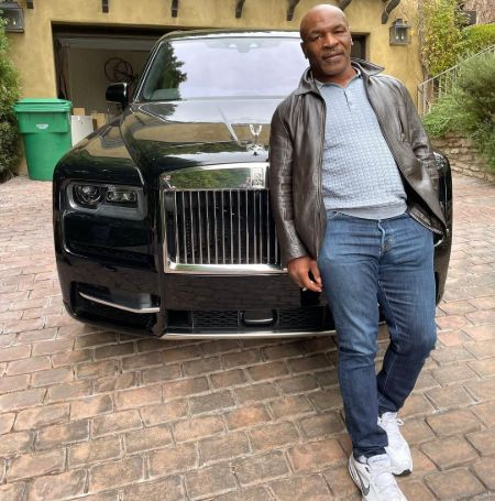 Mike Tyson with his car