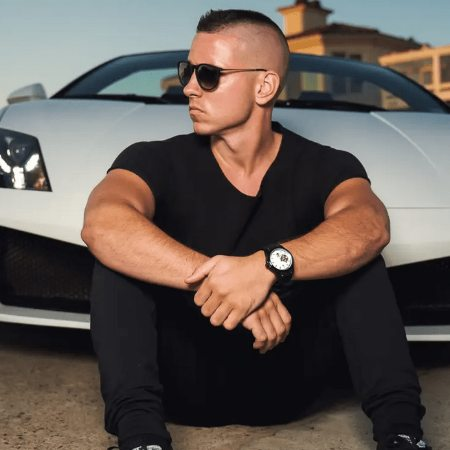 Kevin David Lehmann one the youngest billionaire in front of his car.