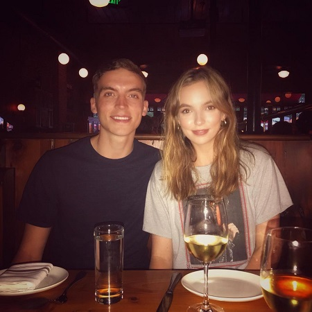 Jodie Comer enjoying her time with her brother in a restaurant