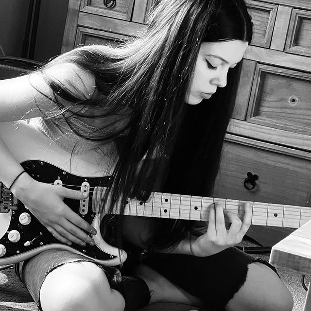The 16-year-old was playing guitar.
