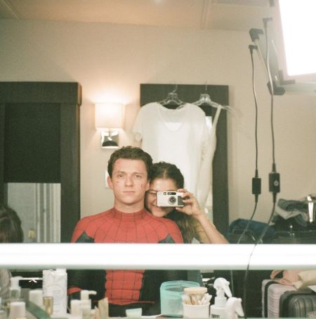 Tom Holland in his Spider-Man costume with Zendaya