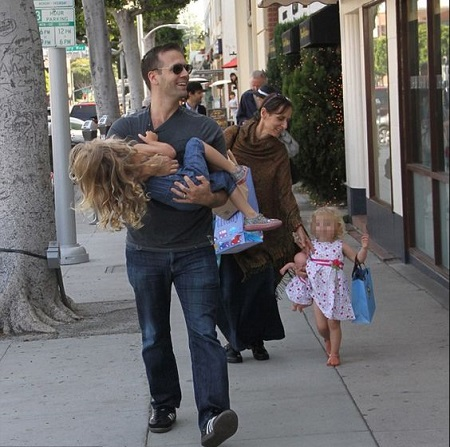 Max Kellerman with his wife and children
