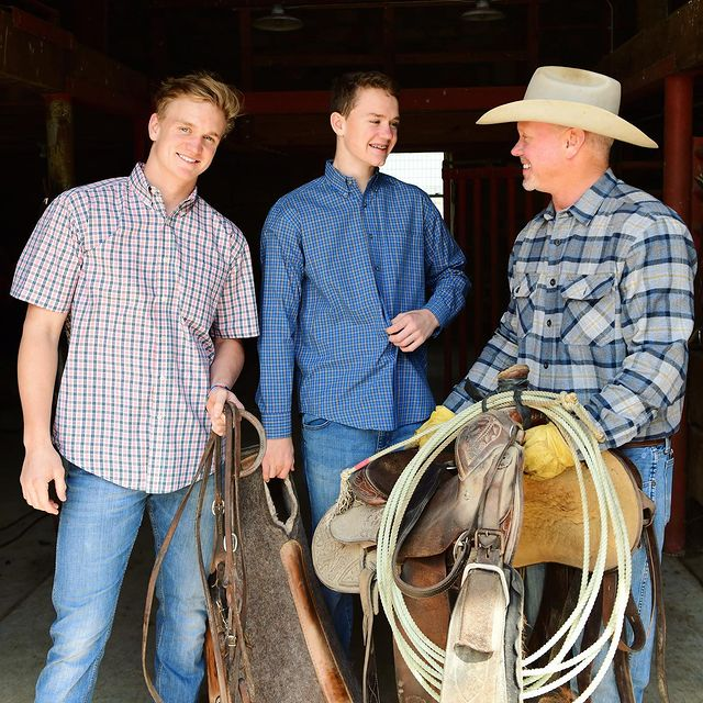Owner of Cattle company with his two sons was about to go in their ranch.