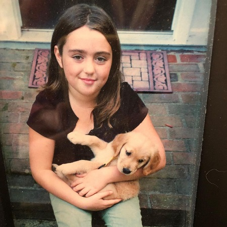 Alexandra Artourovna Yatchenko posing with her doggie when she was at her high school