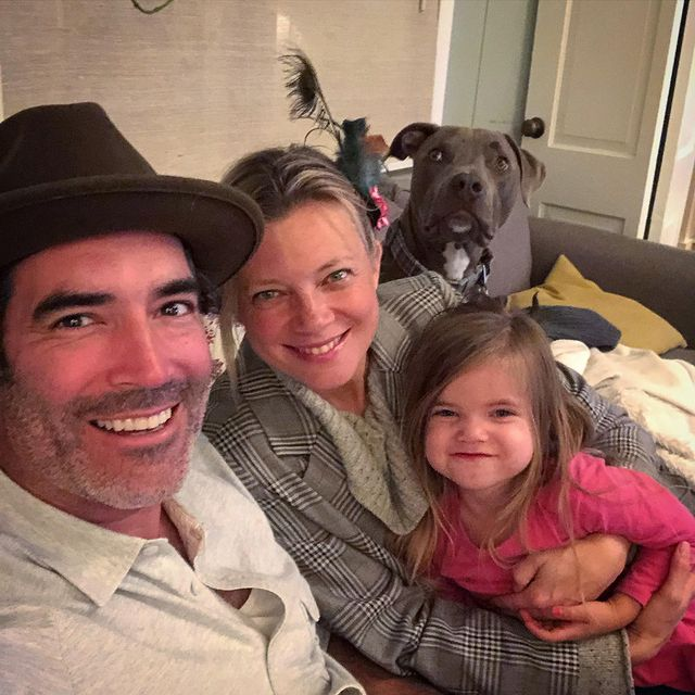 Smart and Carter Oosterhouse were taking a picture with their daughter.