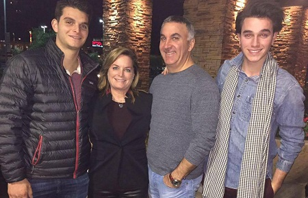 Cameron Gellman attending a party with his family
