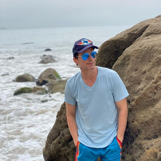Matt was posing for a picture on the seashore.