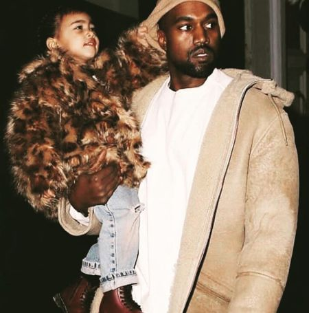 Kanye West with his daughter