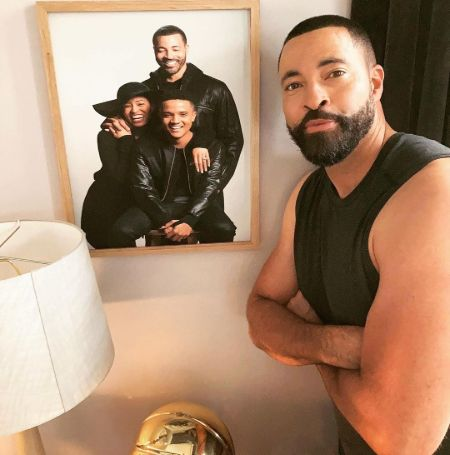 Timon Kyle Durrett was looking at the picture of Queen Sugar cast