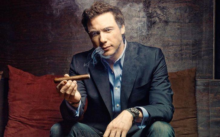 Rocco DiSpirito smoking a Cigar